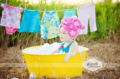 Copyright © Butterfly Photography By Kimberly Chorney. Baby in Bubble Bath with clothesline backdrop. Love this photo idea.