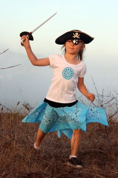 Great directions for a two-bandanna pirate skirt - plus use the circle cut from the bandanna to applique on a matching shirt!