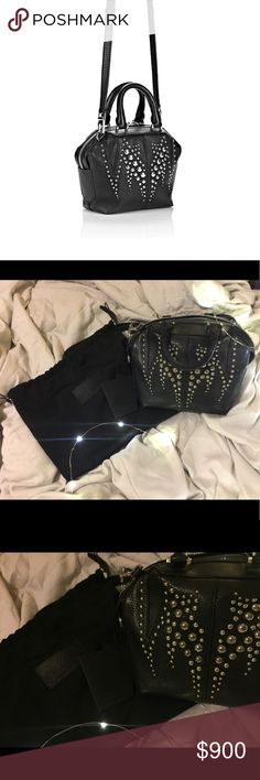 Alexander Wang Studded Emile Mini Alexander Wang Studded Emile Mini✨ From Fall 2015 Collection✨ Absolute jaw dropping piece from Wang, I died when I saw this bag and HAD to have...loved this one, now I'm ready to part with her, I get complimented all the time, definitely a statement. You can wear this as a cross body or take the strap off and make it a hand bag. Still in very good condition, comes with original dust bag and tags. Willing to trade ONLY for another designer bag of equal or…
