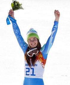 Tina Maze becomes the first person to win Slovenia a gold medal at the Olympic Winter Games