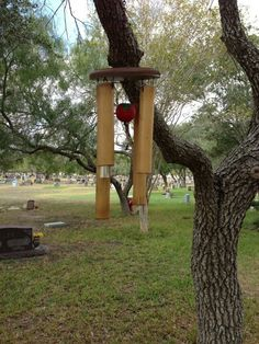Wind chimes cache. This is a neat idea; it would be easy to hide a bison tube in one of the chimes, perhaps with a magnet to hold it in place so it isn't complicated to get it in & out.