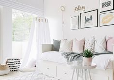 It's rare for a room to be calming and invigorating at the same time, but this bedroom is pulling off the feat. Busy patterns mix with lazy ones. Soft textures contrast with sleek surfaces. Sophistication meets playful. And it's a bedroom that belongs to a 10-year-old girl!