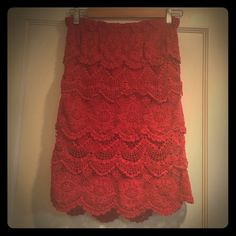 Red Lace Skirt This vava voom red lace skirt by Staring at Stars has the perfect sexy-vintage vibe. With an elastic waist, it's comfy and a good choice to wear if you want to indulge at the buffet. Wear this knee-length, pencil style with a tight sweater, pearls, and heels. Staring at Stars Skirts Pencil