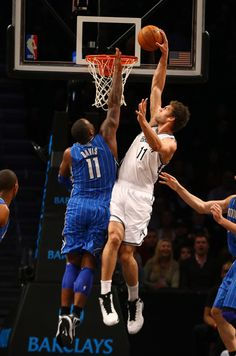 Brook Lopez #11 of the Brooklyn Nets dunks the ball against Glen Davis #11 of the Orlando Magic during their game at the Barclays Center on January 28, 2013 in the Brooklyn borough of New York City.