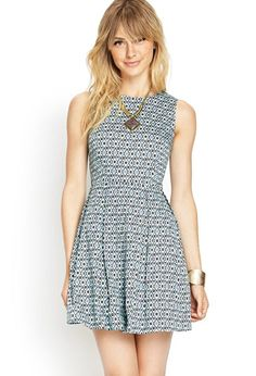 Love 21 - This vintage-inspired A-line tea dress features a full box-pleated skirt and a round ne...