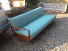 Recovered and repolished Danish sofa/day bed.