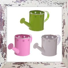 Colourful metal watering cans