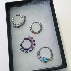 Someone was in the mood of colorsss these are so so pretty! In this pic: BOMBAY KAIA CHARLOTTE and AMERI! all up on the site now with more styles!  holiday sale 20% off site wide happening right now! Enter code 'GEM' at checkout! Save extra on Last Call items! SHOP LINK IN BIO  #septum #piercings #bodymods #opa #pastel #luna #moon #stars  #Rainbow #kitty #celestial #gems #tribal #shiny #mystic  #sparkly #feels #septumrings #pastels #boho #wanderlust #kawaii #jewelry #adornment #gold…