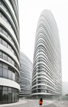These new images by German photographer Robert Herrmann show the near-complete external structures of Zaha Hadid's Wangjing Soho complex, which is scheduled to open later this year in Beijing.
