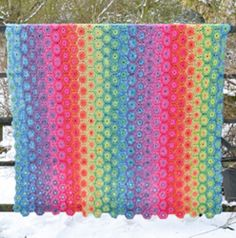 How about a rainbow blanket?   http://www.patternfish.com/patterns/12255