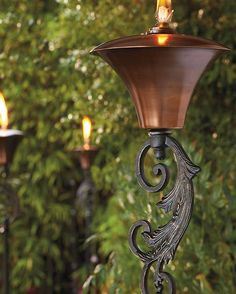 With a beautifully aged copper finish and delicate scrollwork, the  Legato Torch enhances the ambiance of your outdoor space and provides a soft glow upon your parties