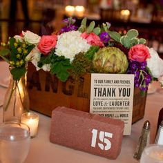 For an added industrial touch to the tablescapes, table numbers were printed on rustic bricks.  vintage boxes hold flower arrangements...
