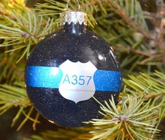 Mess free 3.15in glass (disc) glitter ornament, Metallic Silver is shown in photo This Thin Blue Line ornament with ID number is a great