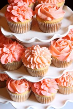 Coral-colored cupcakes -- beautiful for a bridal shower party.
