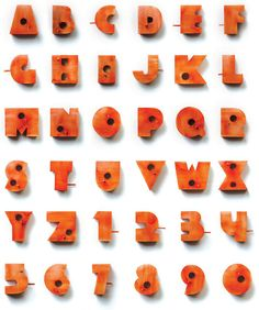 nishant jethi: living typography the entire alphabet and numbers 0-9, recreated in hollow wooden 3D form, acting as birdhouses, letters can be hung outside one's abode as a nameplate or address number