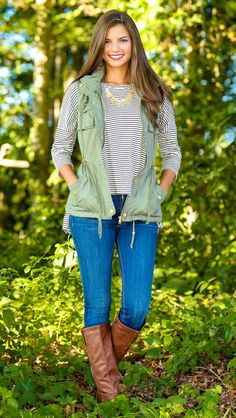Black and white stripes with denim, green vest and boots
