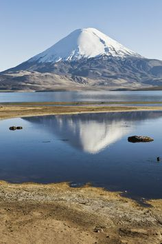 'Parinacota volcano reflecting in the Chungara lake, Lauca national park, Arica and Parinacota Region, Chile' South American Countries, Easter Island, Beautiful Places To Travel, Mountain Landscape, Science And Nature, Volcano, Vacation Spots, Places To See, National Parks