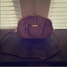 Burberry Crossbody Bag Beige small orchard. Beautiful just not my style, bought from another posher. Not sure of authenticity, I thought I had receipt for this bag but it was for another one. Went to Burberrys to get it authenticated but they said they don't do that, so selling as if it wasnt because I dont want to go through the trouble. First come first serve. Used maybe 5-6 times. Burberry Bags Crossbody Bags