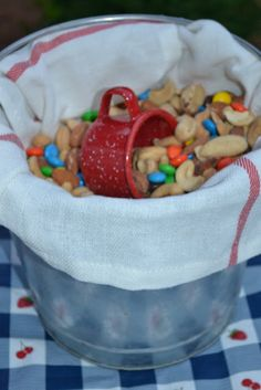 Trail mix in a metal bucket (we could use bandanas instead of a towel)