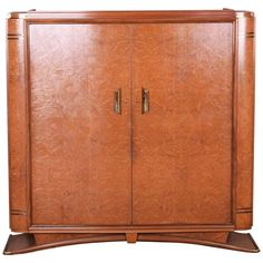For Sale on 1stdibs - 20th century Art Deco closet Completely restored. Material: Palisander, Elm Source: France- Paris Mark F. Pigeon. We guarantee safe a the cheapest air
