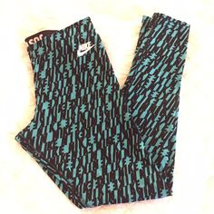 NIKE Leggings Fun and comfy leggings from NIKE. Worn a few times. Turquoise with all over Nike. 56% Cotton/33%Polyester/11%Spandex Nike Pants Leggings