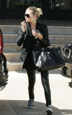 This is Ashley  Olsen who plays Michelle on full house.... She has on leather+ converse!