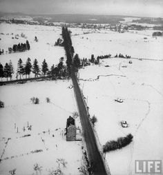 Aerial view over Ardennes showing wrecked tanks at a crossroad where fighting was almost the bitterest during the Battle of the Bulge.