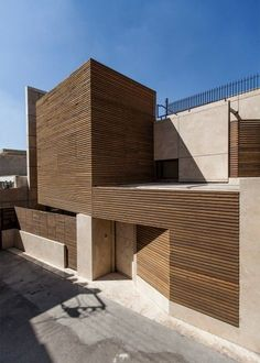 Timber slats allow light to filter in through this Iranian house without compromising privacy