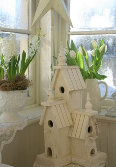 Am planning on several white on white bird houses at side garden around fence row.