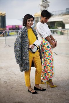Miroslava Duma and friend at Paris Fashion Week Spring 2014. Street style friends #street #style #look