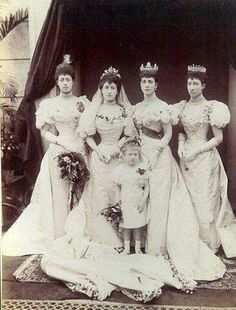 Maud on her wedding day. L to R - Princess Victoria, Princess Maud, Queen Alexandra, Princess Louise. The little girl in front is Lady Alexandra Fife, Louise's daughter.