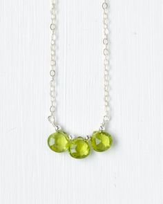 This delicate necklace features three faceted peridot briolettes suspended from a sterling silver chain. Lobster clasp closure. Can also be made in gold fill.Peridot is the birthstone for August.  Elegant and understated handcrafted birthstone jewelry by Blue Room Gems.