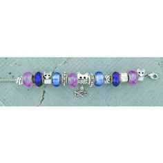 Remember the love and companionship of your beloved pet when you wear this pretty charm bracelet. The charms represent the many things in a cat's life. $29.99