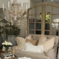 using old doors and windows to section off seating areas..love that idea