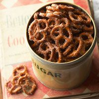 cinnamon sugar pretzels  2/3 cup vegetable oil   1/2 cup sugar   2 teaspoons ground cinnamon   1 1 pound package small pretzel twists     In a large roasting pan stir together oil, sugar and cinnamon. Add pretzels; toss well to combine. Bake, uncovered, in a 300 degree F oven for 30 minutes, stirring twice. Spread on waxed paper to cool. Store in an airtight container. Makes 12 cups.
