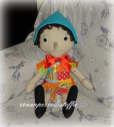 Con un pezzo di stoffa .... Pinocchio