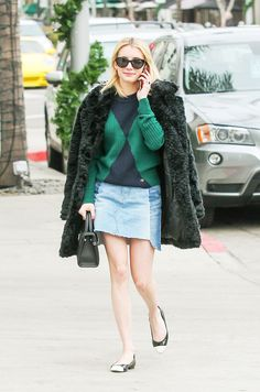 See the winter outfit combination Emma Roberts just wore with classic ballet flats and shop her look here.