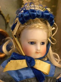 "Lilas is a 15"" Rohmer.  Marie Antoinette Léontine Rohmer began making dolls in partnership with her mother in 1855.  Mme. Rohmer, a proficient seamstress who focused on children's clothing, was a profound influence on Léontine."