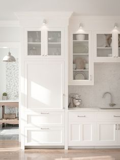 white kitchen : Huestis Tucker Architects, LLC  Also lighting options in lieu of recessed