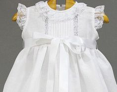 Baptism dress for baby girl made from ivory organza, ivory laces and front sattin bow. Special ocassion like Christening, weddings, birthday Girls Smocked Dresses, Little Girl Dresses, Baptism Dress, Christening Gowns, Baby Dress Patterns, Frocks For Girls, Kurti Designs Party Wear, Lehenga, Girl Outfits