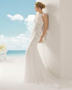 VEGA vestido de novia en tul sedoso y pedrería .