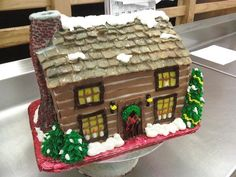 Christmas Cabin -  A log cabin all decorated for the holidays. This is Strawberry Cake with Chocolate Buttercream