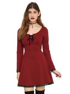 <p>Burgundy dress with black lace trim and black velvet lace-up detailing on front & back.</p>  <ul> <li>72% polyester; 23% rayon; 5% spandex</li> <li>Wash cold; line dry</li> <li>Imported</li> </ul>