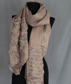 A beautiful sequined polyester scarf in light brown with a shimmer of gold appearance. An elegant scarf for any occasion to finish off any outfit in style.