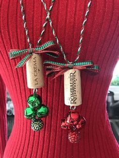 The perfect gift for your wine lover friends and family! Handmade Cork Ornaments and Necklaces . They are available immediately just in time for your fun holiday parties. Give them to your favorite party host, attach to a pretty wine bottle. The cork necklaces are made with bells and are #GiftsForWineLovers