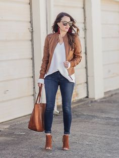 Since early spring can still be a bit chilly, we are showing you how to wear leather for spring today on Peaches In A Pod.