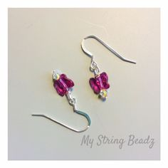 Butterfly & Buds...are darling earrings with a bit of lovely for adults or children alike! Swarovski crystal butterflies ( in a colour of your choice ) are paired with swaovski crystals and sterling silver ear wires or posts!