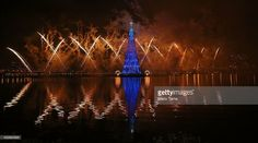 Fireworks explode during the lighting ceremony for Rio de Janeiro's famed floating Christmas tree in Lagoa Rodrigo de Freitas on November 30, 2013 in Rio de Janeiro, Brazil. The constructed tree is the largest floating Christmas tree in the world according to the Guinness Book of World Records. The tree is 85 meters tall and is displayed by three million microlights.  (Photo by Mario Tama/Getty Images)