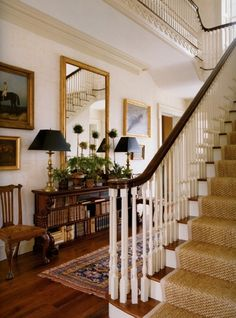 The Great American House. This foyer is fabulous. Stair runner and oriental rug. Picture wall gallery with mirror. Lamps.