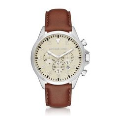 Michael Kors Brown Gage Watch Capturing the essence of the jet set lifestyle, Michael Kors' Gage features a dark brown leather strap and a cream dial.